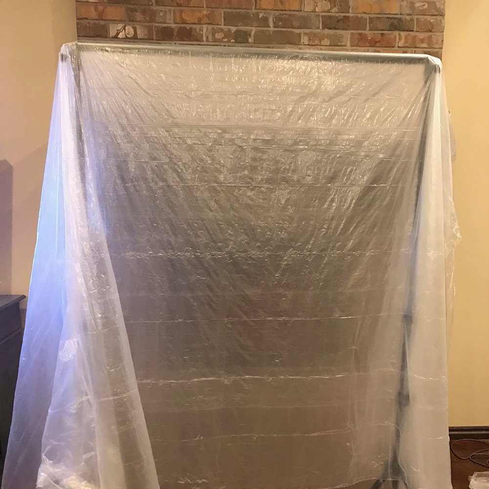Plastic dust shield for the fireplace demo.