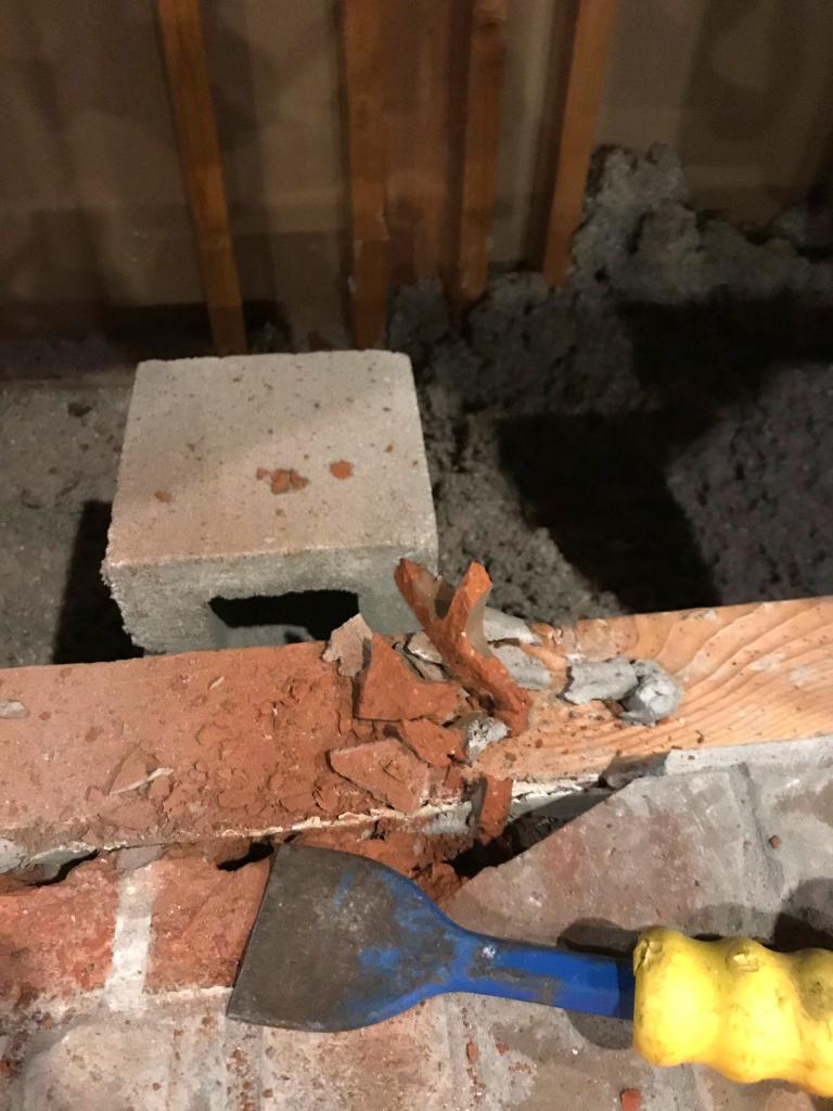Leveling bricks for fireplace platform