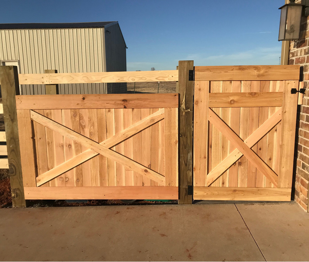 Cedar fence and cedar gate to complete our split rail fence.