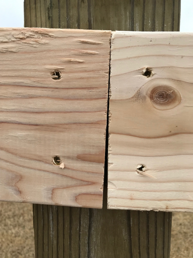 Attach side rails to center of posts of a split rail fence.