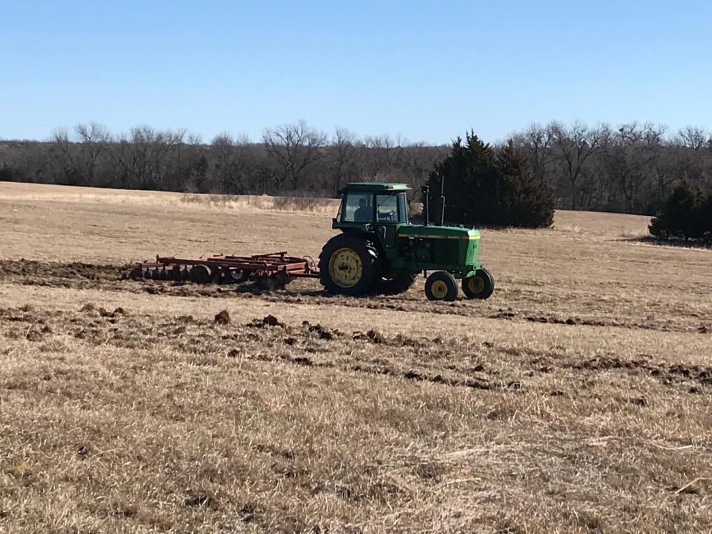 Using a disc plow to prepare the soil for planting wildflowers